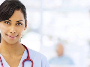 Female Nurse Holding Clipboard In Hospital